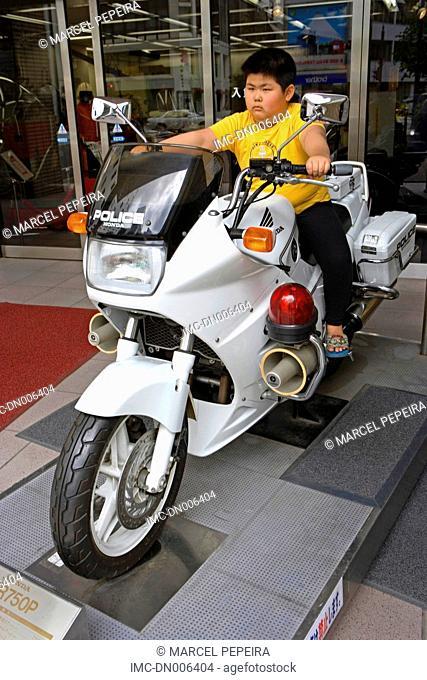 Japan, Tokyo, Ginza, child on a motorbike