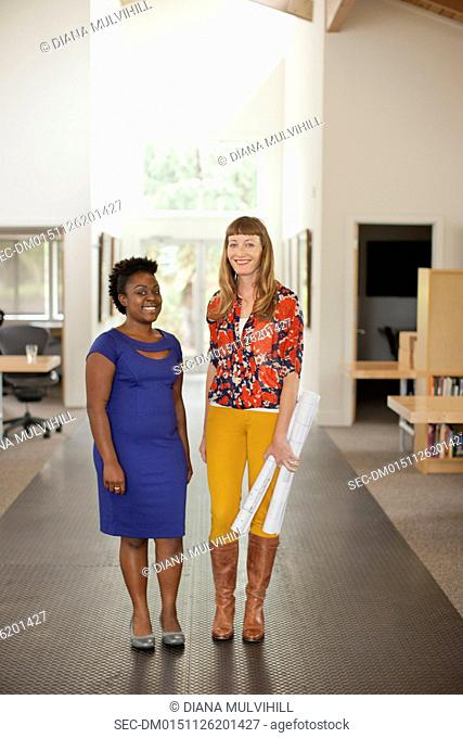 Portrait of two female workers in office