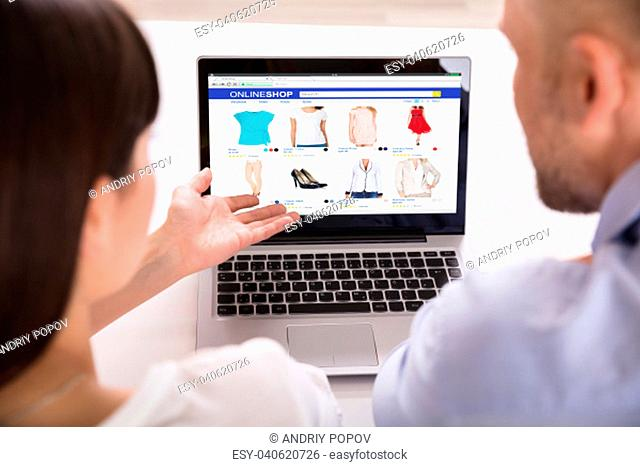 Close-up Of A Couple Using Laptop For Shopping Online