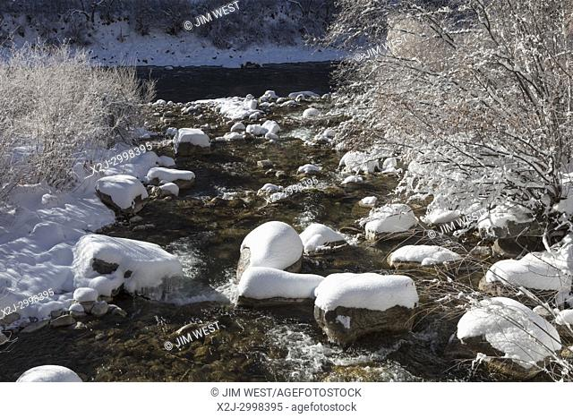 Glenwood Springs, Colorado - Grizzly Creek flows into the Colorado River in winter in Glenwood Canyon