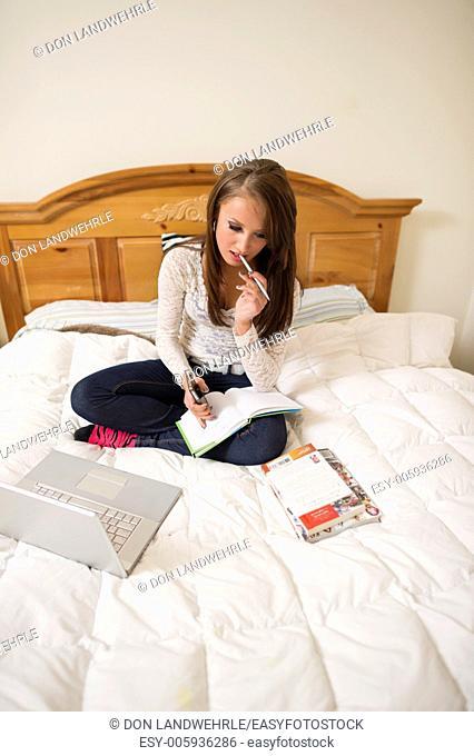 woman teenage girl bed teen homework laptop