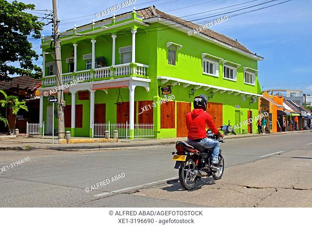 green painted building and motorcycle, Cartagena de Indias, Colombia