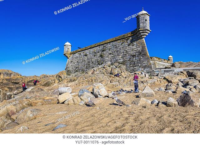 View from Atlancit Ocean beach on Fort of Sao Francisco do Queijo also knows as Castle of the Cheese in Porto, second largest city in Portugal