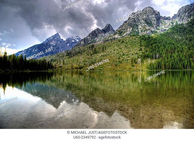 The Tetons are reflected in String Lake at Grand Teton National Park, Wyoming