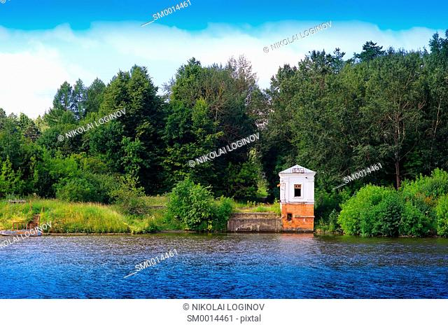 Vintage building on river bank landscape background hd
