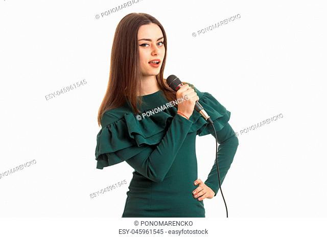pretty young woman in green dress singing song with karaoke isolated on white background