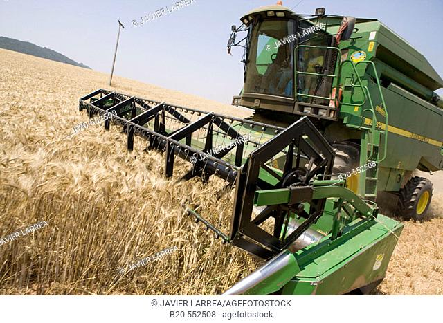 Agricultural machinery. Combine harvester on field of wheat. 'Learza' estate. Near Estella, Navarre, Spain