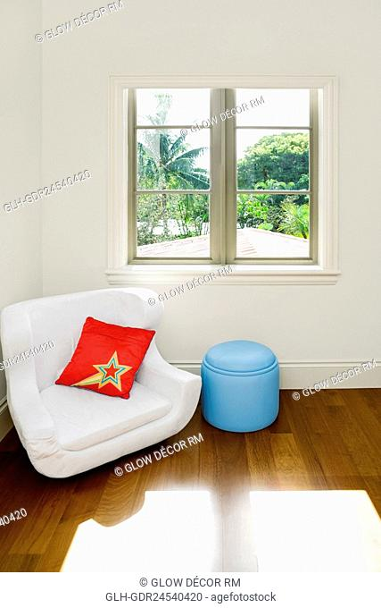 Armchair and an ottoman in a living room
