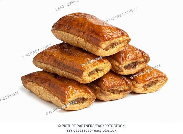 Fresh baked sausage rolls on white background