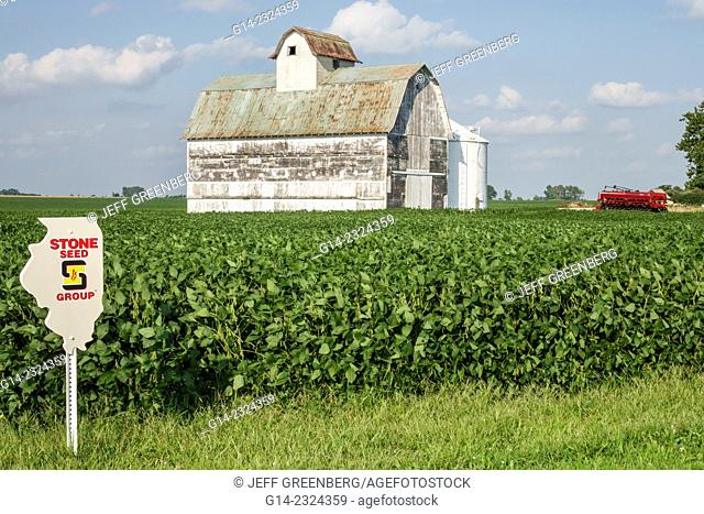 USA, Illinois, Tuscola, barn, rural farming, harvester combine, soybean, seed marker