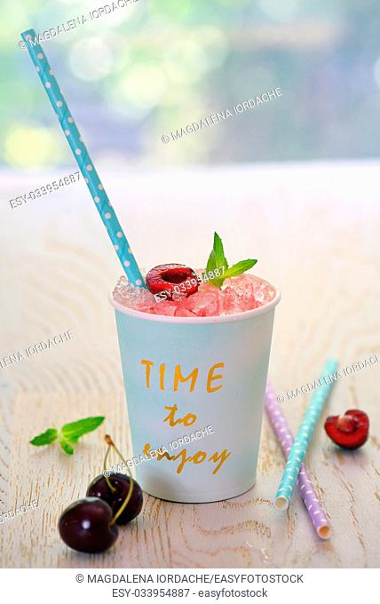 cherry syrup with ice in summer time