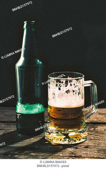 Glass and bottle of beer on table