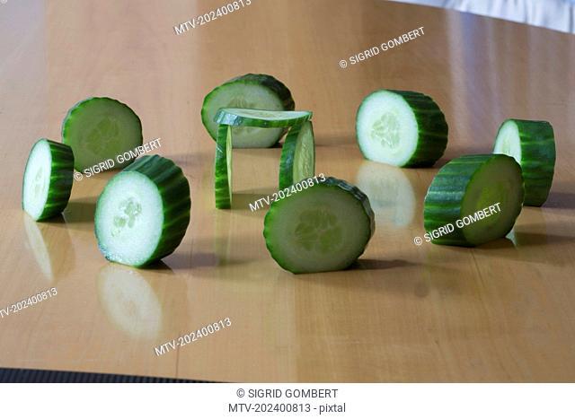Close-up of slices of cucumber making stonehenge on table
