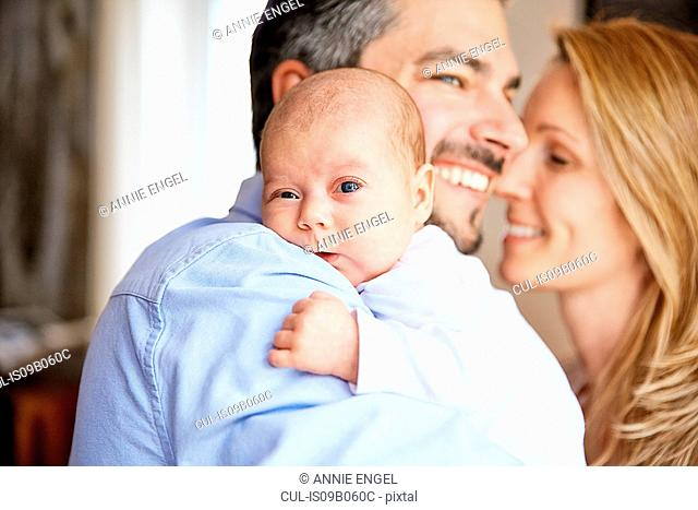 Portrait of baby girl over her fathers shoulder