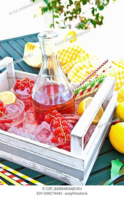 Homemade lemonade with fresh red currant