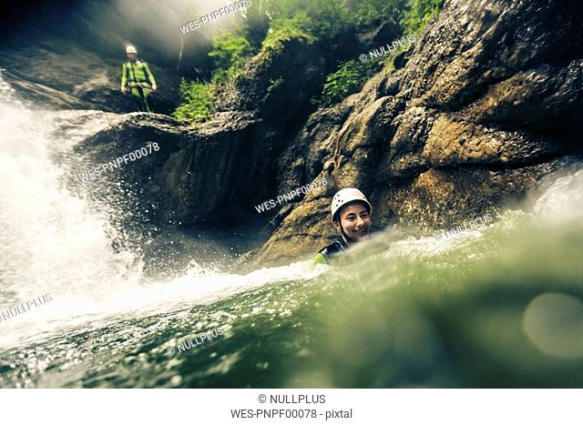 Germany, Bavaria, Allgaeu, young couple canyoning in Ostertal