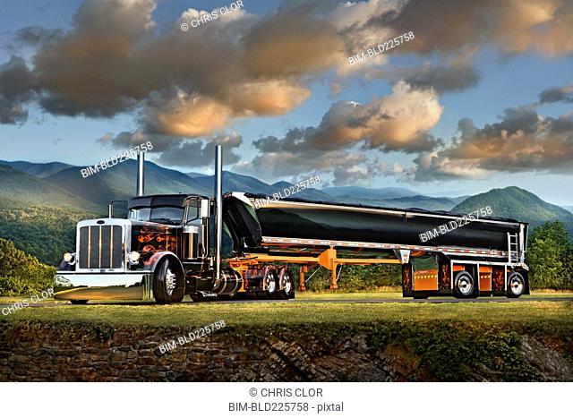 Semi-truck driving near mountain range