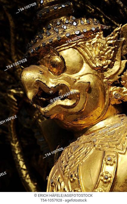 Guardian mythical demons supporting golden chedi, Grand Palace, Bangkok, Thailand