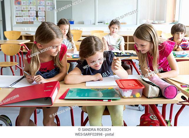 Three schoolgirls at class