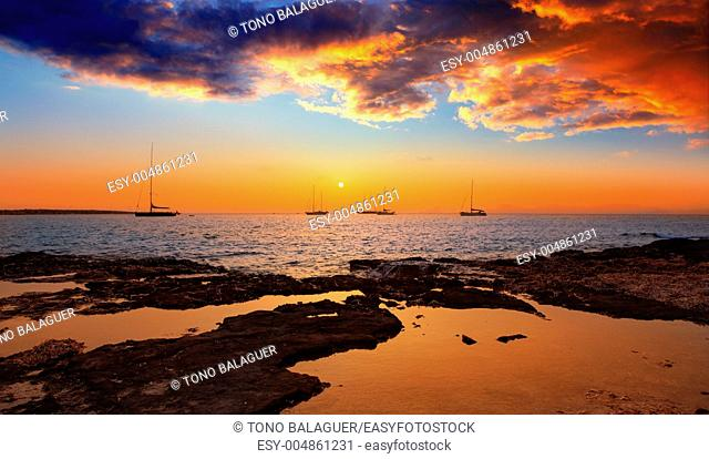 colorful sunset of Ibiza view from formentera with Es Vedra