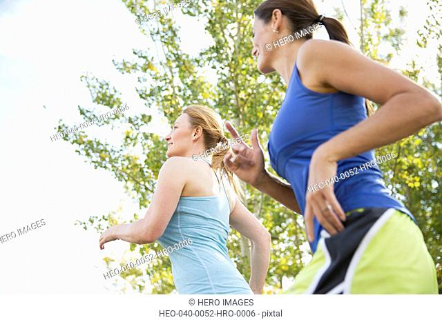 Two women running outdoors together