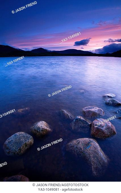 Scotland, Scottish Highlands, Cairngorms National Park  Deep red clouds above Loch Morlich and the surrounding mountains