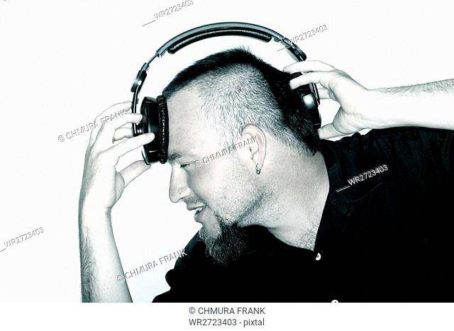 adult, audio, casual, Caucasian, cool, earphones, enjoy, entertainment, guy, hairstyle, headphones, isolated, lifestyle, listen, male, man, modern