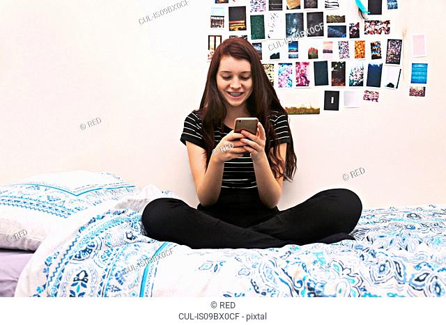 Teenager social networking on bed