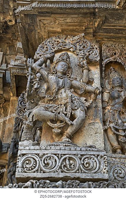 Sculpture of dancing Shiva, west side walls, Hoysaleshwara temple, Halebidu, Karnataka, india. view from West