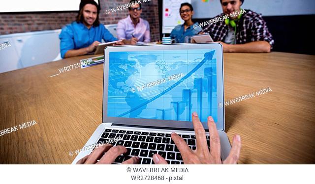 Woman using laptop in meeting