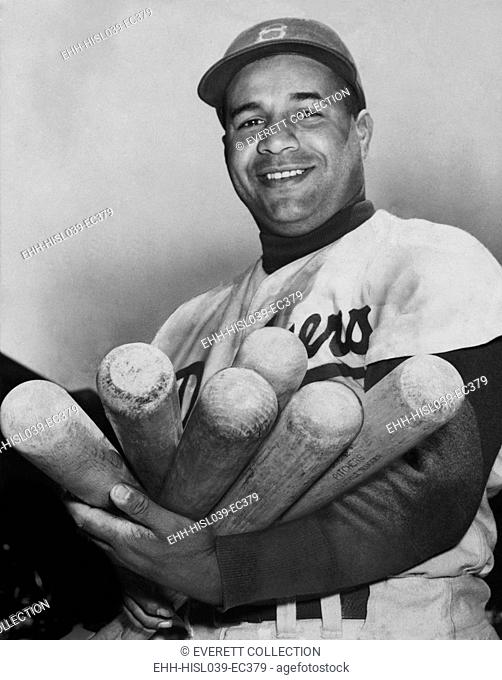 Roy Campanella, catcher for the Brooklyn Dodgers, holding six bats, June 4, 1953. He was one of the first Major League Baseball players of color when he joined...