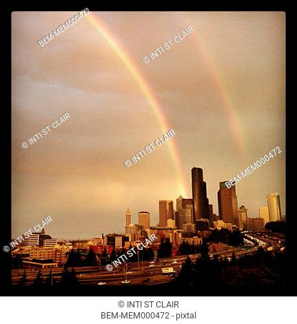 Rainbow stretching over city skyline, Seattle, Washington, United States