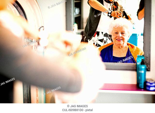 Woman working in quirky hair salon