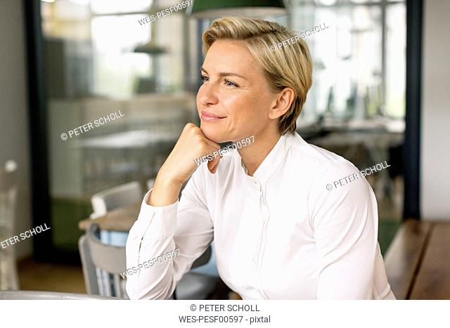 Portrait of confident blond woman looking sideways