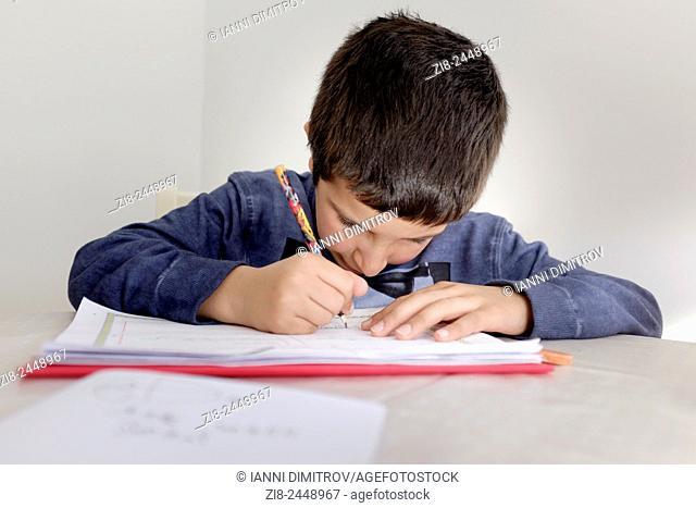Primary schoolboy working on his homework