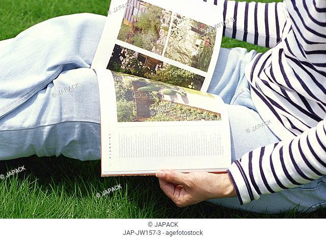 Women reading a book on gardens