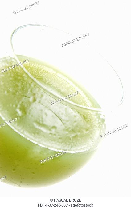 Close-up of a glass of kiwi juice