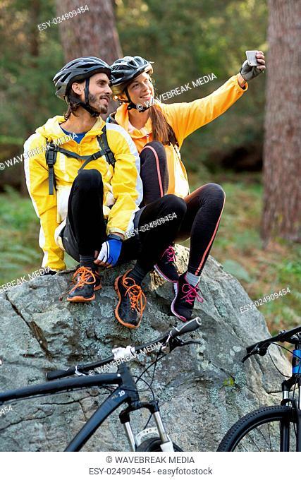 Biker couple taking selfie from mobile phone