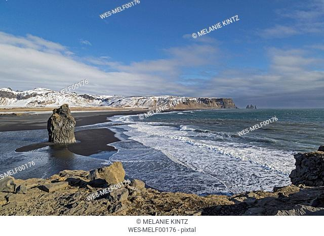 Iceland, Vik, black beach and eastward view towards Reynisdrangar