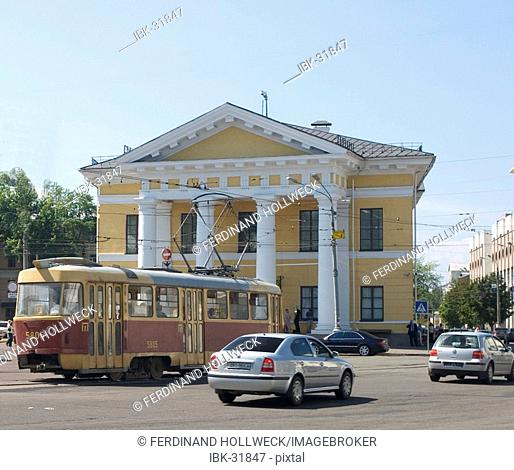 Ukraine Kiev district Podil Kontraktova Place oldest place of town view to the historical building of contrakts and the tram traffic with cars and walking...