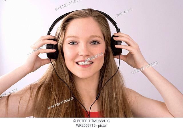 Teenager with headphones listening to music