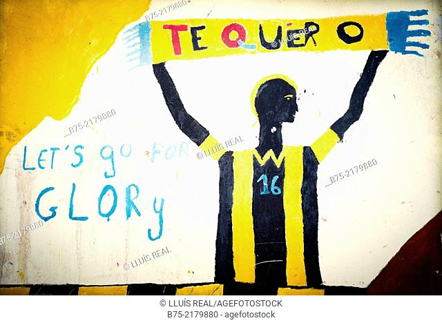 Graffiti on a wall with handwritten text 'te quiero', I love you and lets go for glory in the Medina of Fez, Morocco, Africa