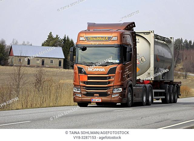 Salo, Finland - April 5, 2019: Bronze Next Generation Scania R580 truck of AH Trans Oy hauls chemical liquid container along highway in Finland