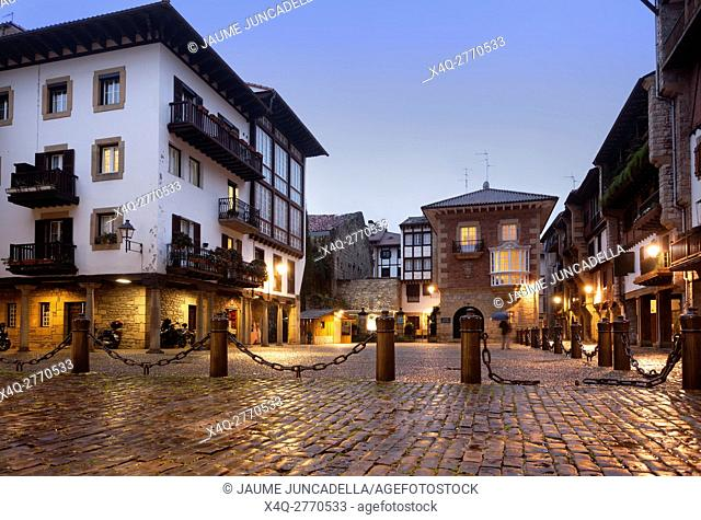 Hondarribia-The Basque Country. Sunset in the village and after rain the light reflect on the cobblestones