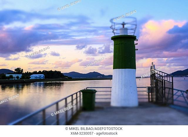Lighthouse in a port. Colindres, Cantabria, Spain, Europe