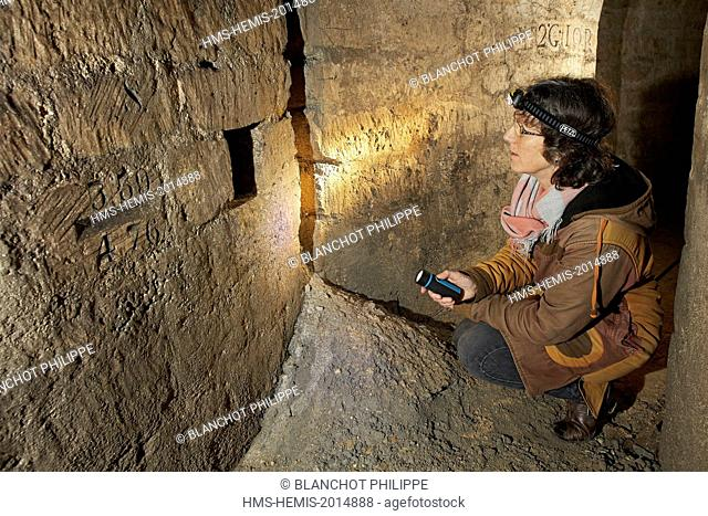 France, Paris, National Museum of Natural History, Christine Rollard, araneologist, illuminating a cavity in the underground quarries under the botanical garden