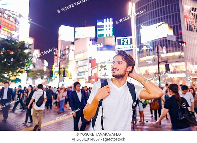 Caucasian man enjoying sightseeing in Tokyo, Japan