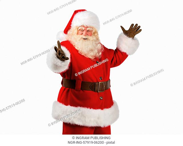 Santa Claus gesturing his hand isolated over white background. Presenting something