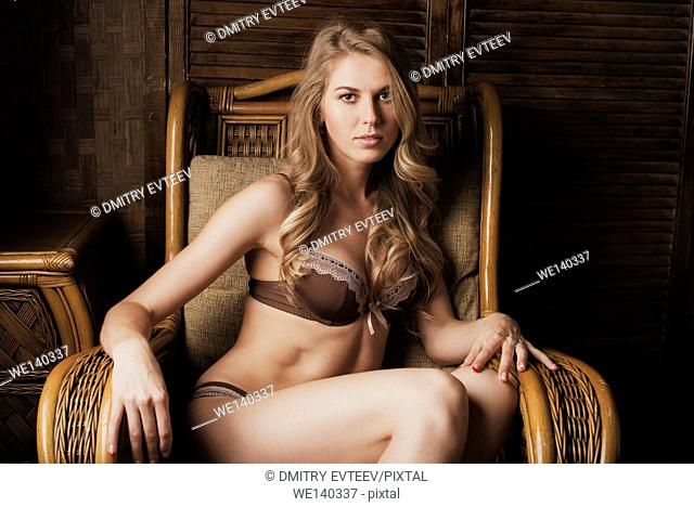 Elegant woman is resting in lounge chair