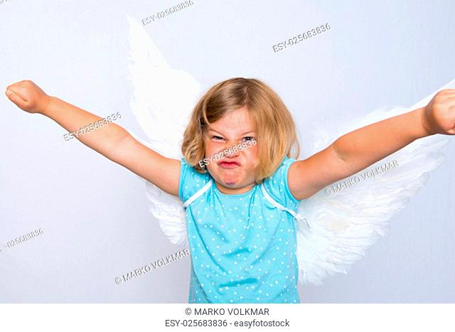 wild blond girl with angel- wings in front of white background